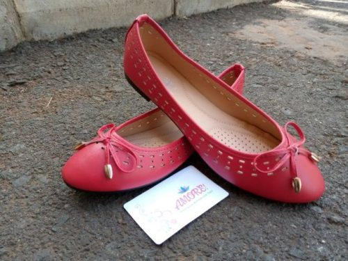 Red perforated doll shoe