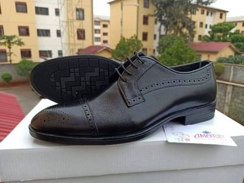 Black wing tip shoe
