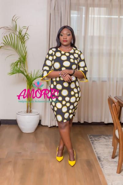 Black, white and yellow polka trumpet sleeve dress