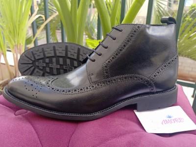 Black brogue boot