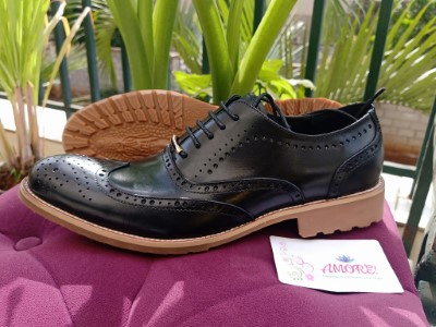 Black brogue with brown sole