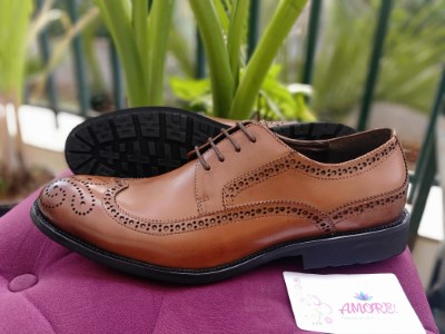 Light brown brogue with black sole